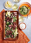 Quinoa tabbouleh with rare lamb and a yogurt dip
