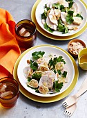 Chicken and artichoke heart salad garnished with parsley