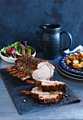 Crisp roast rack of pork with lemon potatoes and salad