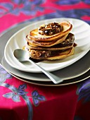 A stack of pancake with chocolate butter