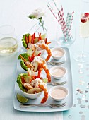 Seafood salad with mayonnaise dressing served in small bowls