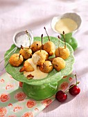 Beer-battered cherries with custard