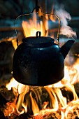 A kettle over a fire in a tent belonging to the Sami people (Kirkenes, Norway)