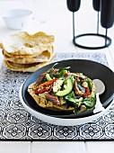 Greek salad with lamb in a crispy pita bowl