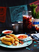Potato taquitos with salsa roja