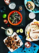 Carnitas tacos with a black bean salad