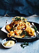 Fried skate with onion rings, parsley and curry remoulade