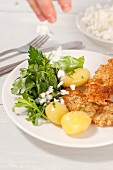 Schnitzel with boiled potatoes and Frankfurt salad