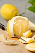A lemon being filleted