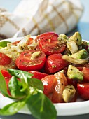 Tomato and avocado salad with onions and olive oil
