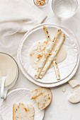 Grilled white asparagus with béchamel sauce, goat's cheese and cashew nuts
