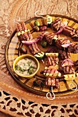 Grilled Turkish kebabs of meat with courgette and onions