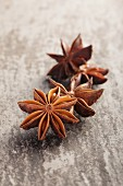 Star anise on a grey surface