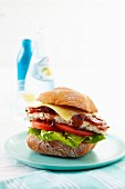 Turkey burger with bacon and barbecue sauce