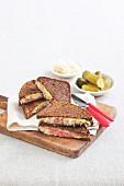 Reuben sandwiches with pastrami and sauerkraut