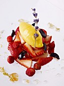 Strawberry salad with olives, mango ice cream and lavender