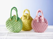 Three cakes shaped like handbags