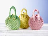 Three cakes shaped like handbags