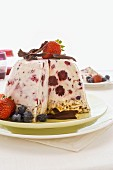 Ice cream bombe with berries, partly slices