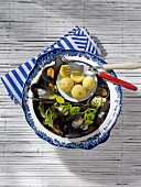 Mussels served with potato dumplings