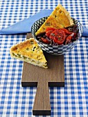 Courgette quiche with tomato and onion salad