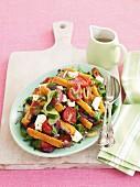 Greek salad with chicken schnitzel