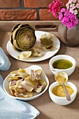 Artichoke leaves with mustard and a herb dip