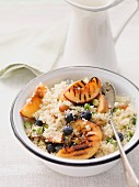 Couscous salad with blueberries and grilled peach wedges