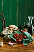 An Italian arrangement with bread, olive oil, tomatoes and red wine