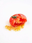 A squeezed tomato against a white background