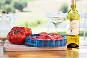 Oxheart tomatoes and white wine