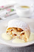 Apple strudel with vanilla sauce