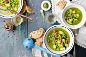 Pesto soup with beans, peas and courgette
