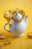 Gingko tea with autumnal gingko leaves in a white teapot