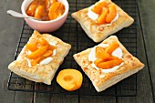 Puff pastry tartlets with yoghurt and lime cream and apricots