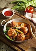 Chicken meatballs with sugar snap peas