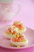 Stuffed eggs with cucumber and prawns