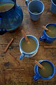 Apple punch with cinnamon in mugs