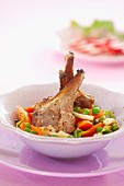 Lamb chops with carrots, peas and parsley root