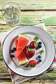 Summer Fruit on a Plate; Watermelon, Blueberries and Strawberries with Mint