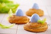 Three yeast baskets with Easter eggs