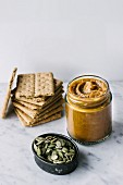 Pumpkin butter, crackers and pumpkin seeds