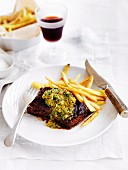 Onglet steak with herb butter and skinny chips