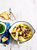 Mushroom omelette with herbs and chunks of baguette