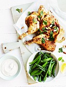 Fried chicken with yoghurt and tahini dressing, lemons and mint