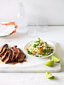 Grilled beef skirt steak with coleslaw (Asia)
