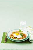 Nasi goreng with satay chicken and a fried egg