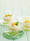 Creamy dessert with mango and lemon balm