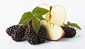 Blackberries and a partly sliced apple