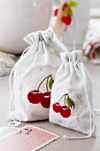 Gift bags embroidered with cherries